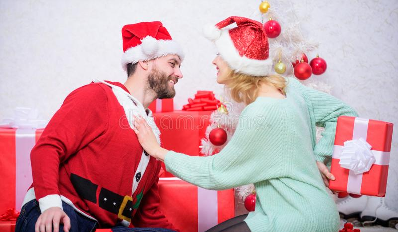 Couple in love happy enjoy christmas holiday celebration. Family prepared christmas surprise. Opening christmas present royalty free stock images