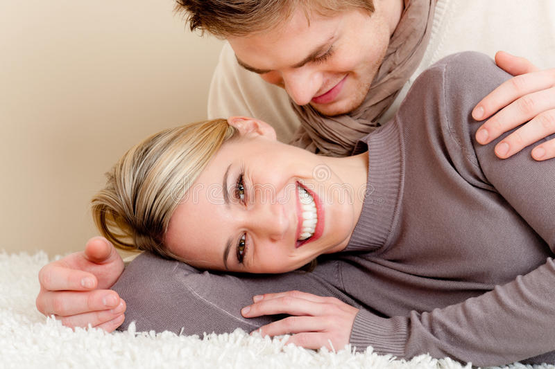 Couple in love - happy relax at home. Together lying down on carpet royalty free stock photography