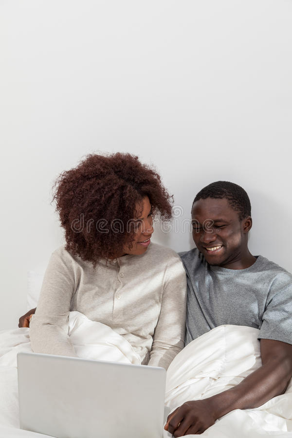 Couple in love have fun using the computer. Black couple in love using the computer royalty free stock images