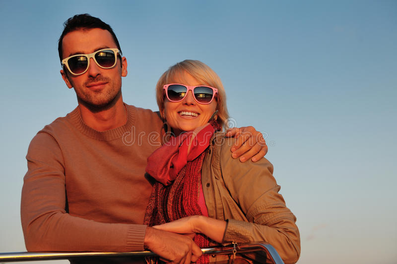 Couple in love have romantic time on boat stock image
