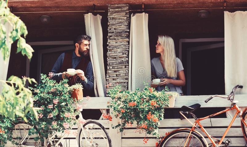Couple in love holds cups of coffee outside. stock image