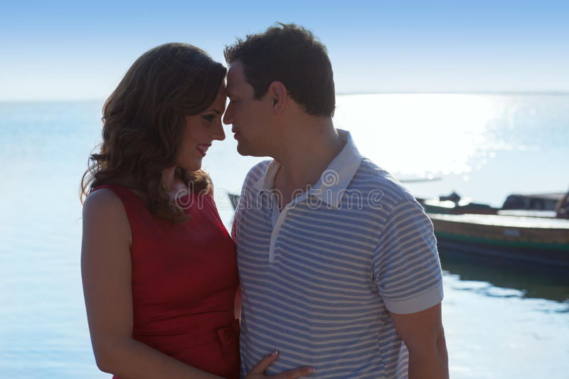 Couple in love hug in suset on sea royalty free stock photo