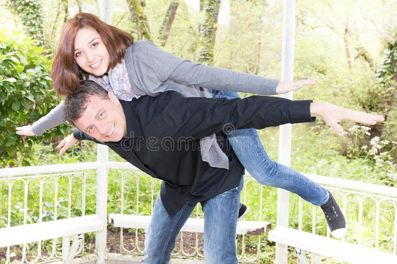 Couple in love hugging enjoys spring day loving man piggyback woman carefree together outdoors royalty free stock image