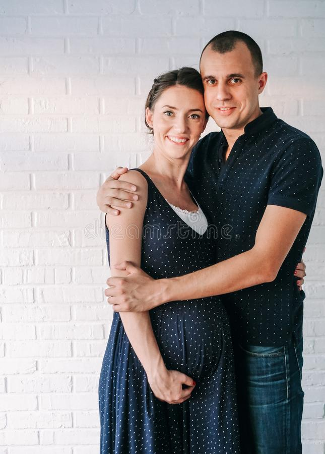 Couple love hugging family pregnant woman stock photo