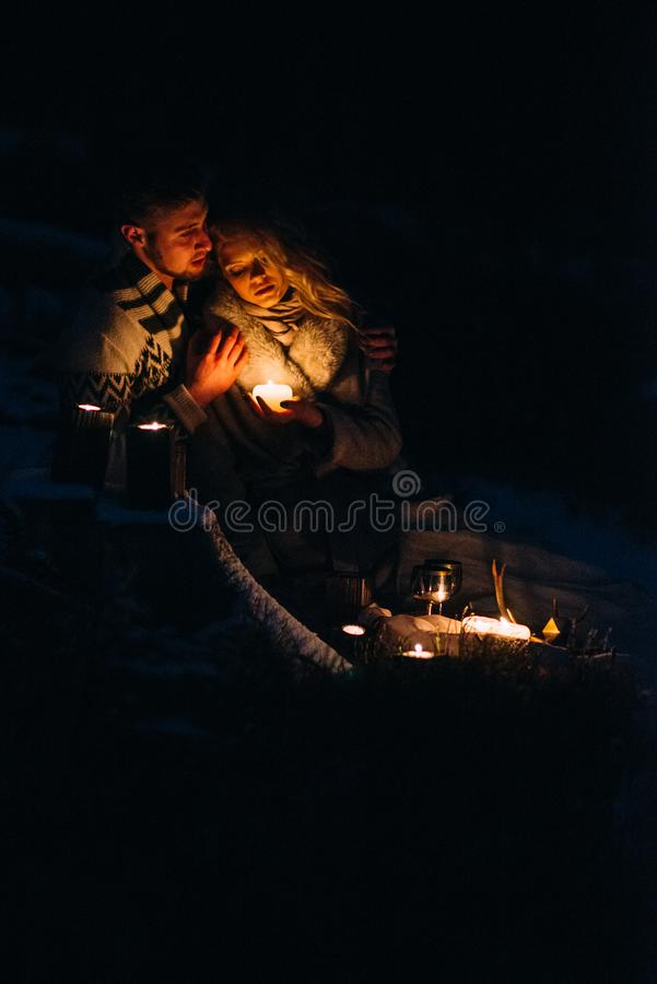 Couple in love hugging the night before Christmas. Loving embrace, light Christmas garland. Guy and girl love each other. stock image