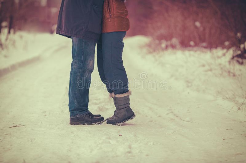 The couple in love hugging outdoors in winter royalty free stock photography