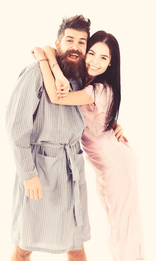 Couple in love hugging in pajama, bathrobe. Couple, family on smiling faces in clothes for sleep looks happy in morning. Perfect morning concept. Couple stock photography