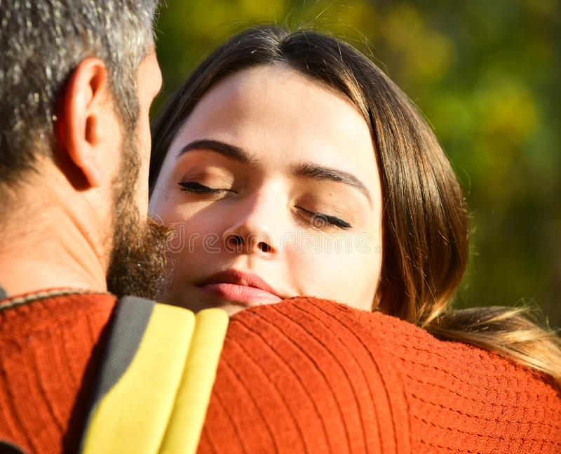 Couple in love hugs on green blurred background, autumn day. stock photos