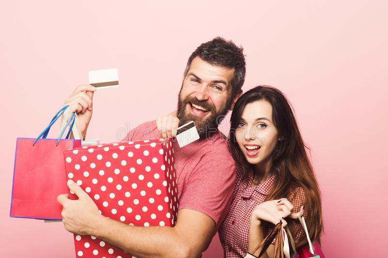 Couple in love hugs holding big box and shopping bags royalty free stock image