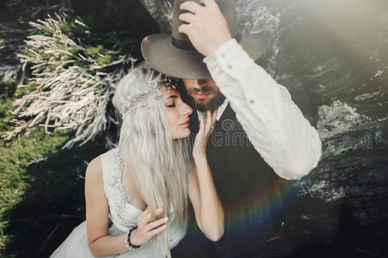 Couple in love kissing in beautiful Matterhorn mountains, Switze. Stylish young wedding couple posing in beautiful Matterhorn mountains, Switzerland royalty free stock image