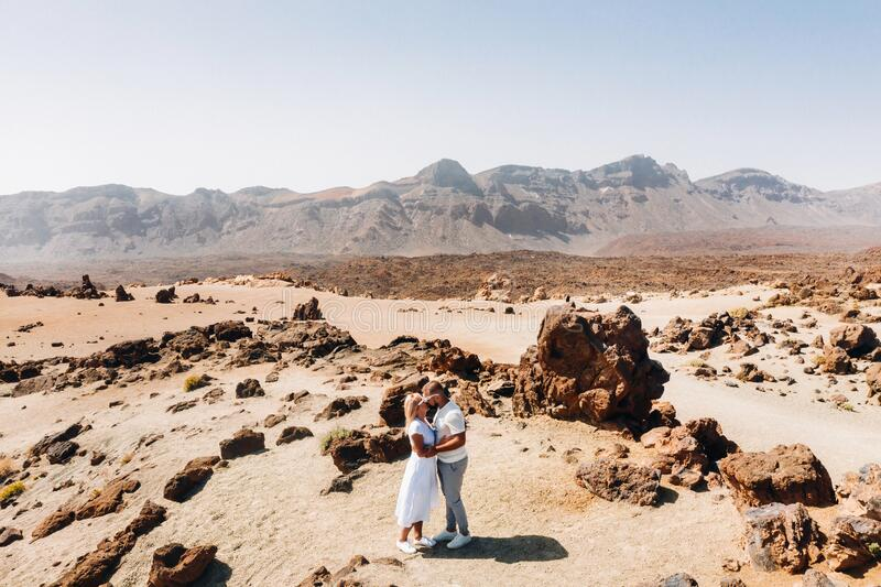 A couple in love kissing in the crater of the Teide volcano.Mars is a desert landscape of the red planet. Teide National Park. Desert crater of the Teide stock image