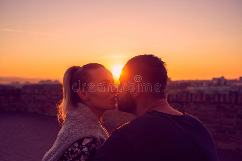 Couple in love kissing at evening  in sunset royalty free stock photography