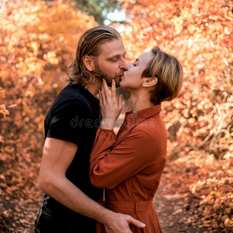 Couple in love kissing in the forest royalty free stock photos