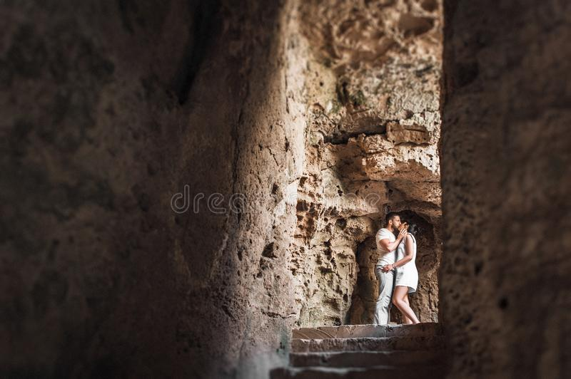 Couple in love kissing in a cave royalty free stock image