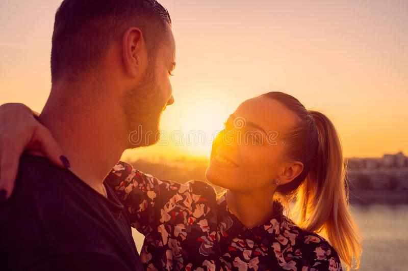 Couple in love kissing laughing and having fun  in sunset stock photography