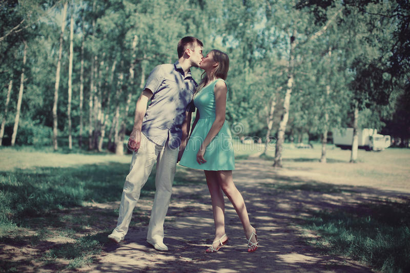 Couple in love kissing. Outdoors royalty free stock image