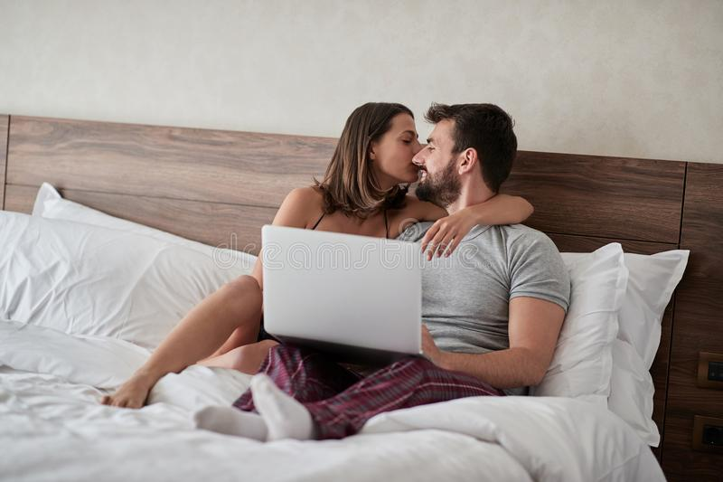 Couple in love kissing - Passionate lovers having romantic and intimate moments on the bed - Sex and passion concept royalty free stock image