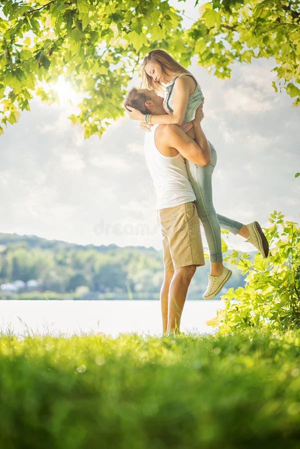 Couple in love on the lake, hug stock photos
