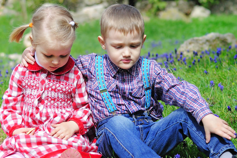 Couple in love little children on green meadow royalty free stock image