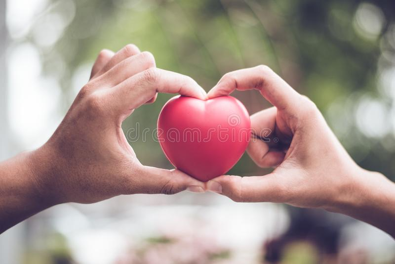 Couple in love making heart symbol shape with finger and hands togetherness. Valentines day concept. Romantic travel trip and stock image
