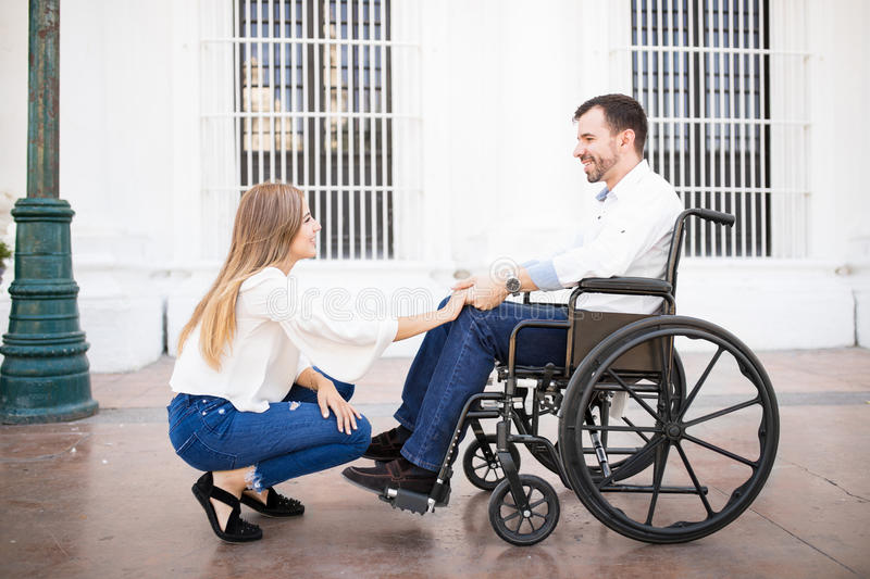 Couple in love, man on a wheelchair royalty free stock photos