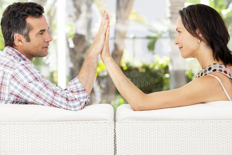 Couple in love - moment of intimacy between middle aged man and woman. Couple in love - moment of intimacy between middle aged men and women - hands together stock photography