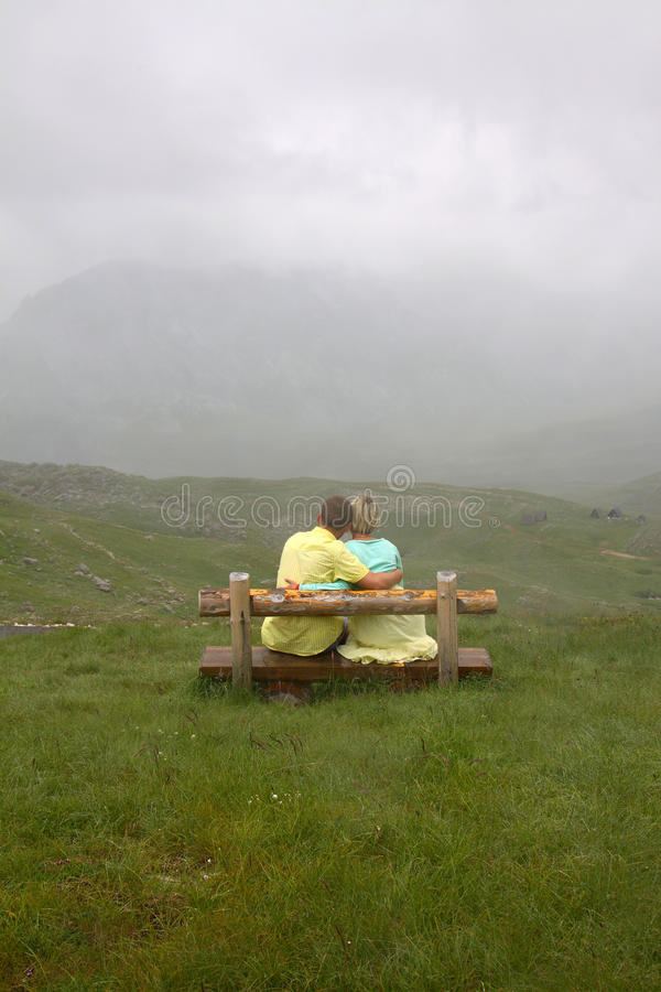 Couple in love on a mountain top stock photography