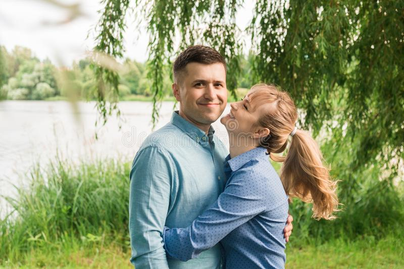 Couple in love in nature. Family walks in the park. Love royalty free stock photo