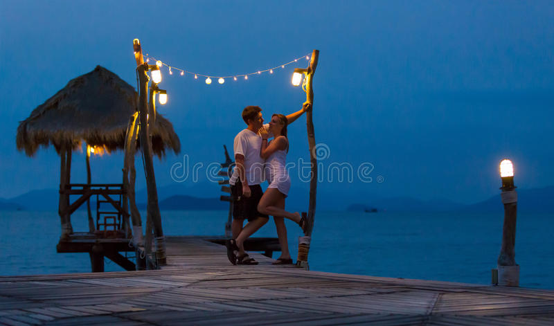 Couple in love. On the night romantic pier stock image