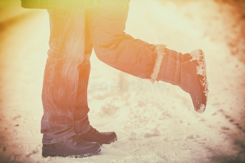 The couple in love outdoors in winter royalty free stock photo