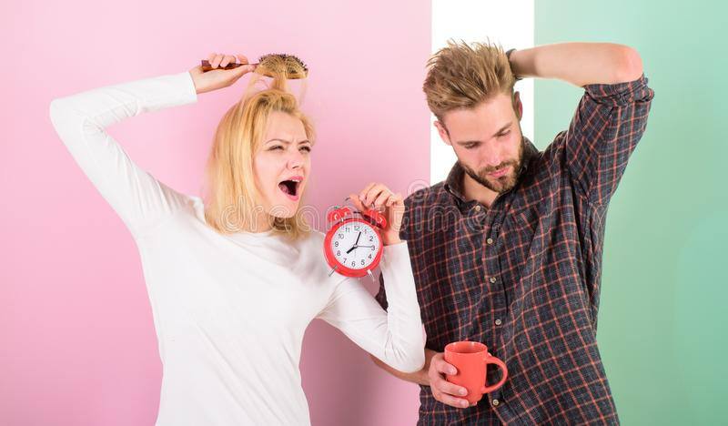 Couple in love overslept morning alarm clock. Couple sleepy faces late for work. Woke up too late. I am going late for. Work. Woman and men sleepy tousled hair stock photography