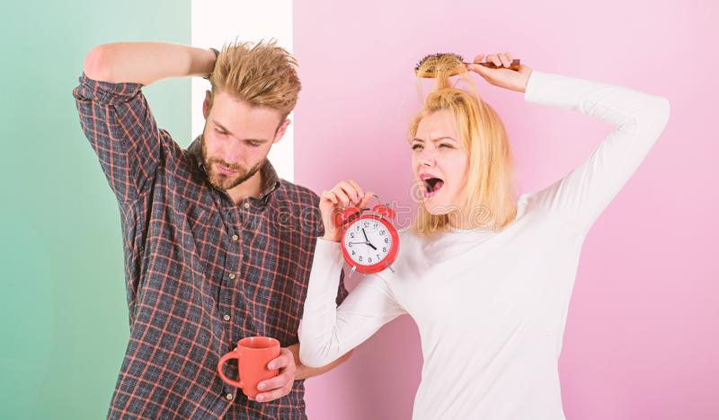 Couple in love overslept morning alarm clock. Couple sleepy faces late for work. Woke up too late. I am going late for. Work. Woman and men sleepy tousled hair royalty free stock photography