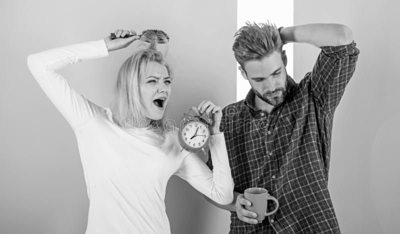 Couple in love overslept morning alarm clock. Couple sleepy faces late for work. Woke up too late. I am going late for. Work. Woman and men sleepy tousled hair royalty free stock photo