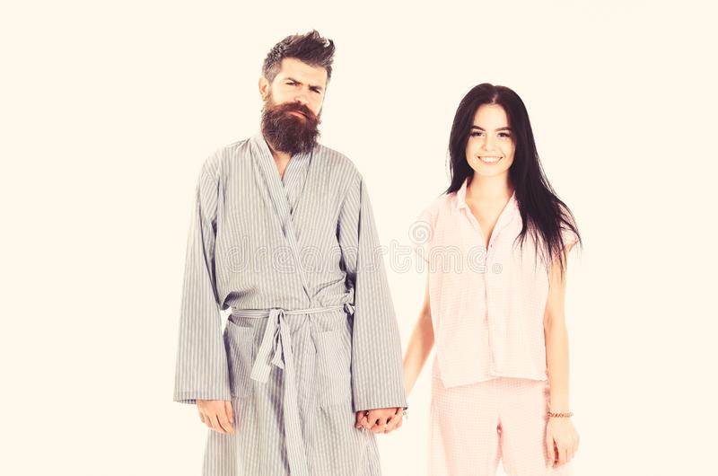 Couple in love in pajama, bathrobe. Couple, family on smiling faces in clothes for sleep looks sleepy in morning. Couple. Hold hands together, on white royalty free stock photos
