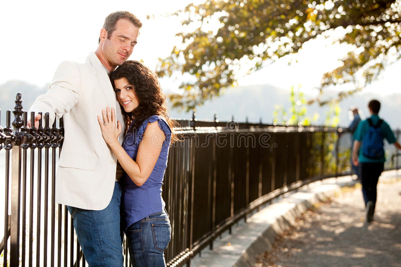 Couple Love Park. A couple huggnig in the park on a path royalty free stock images