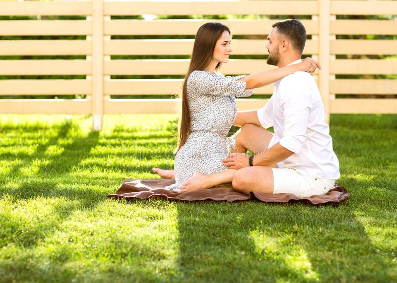 Couple in love on a picnic near their home, American style. stock images
