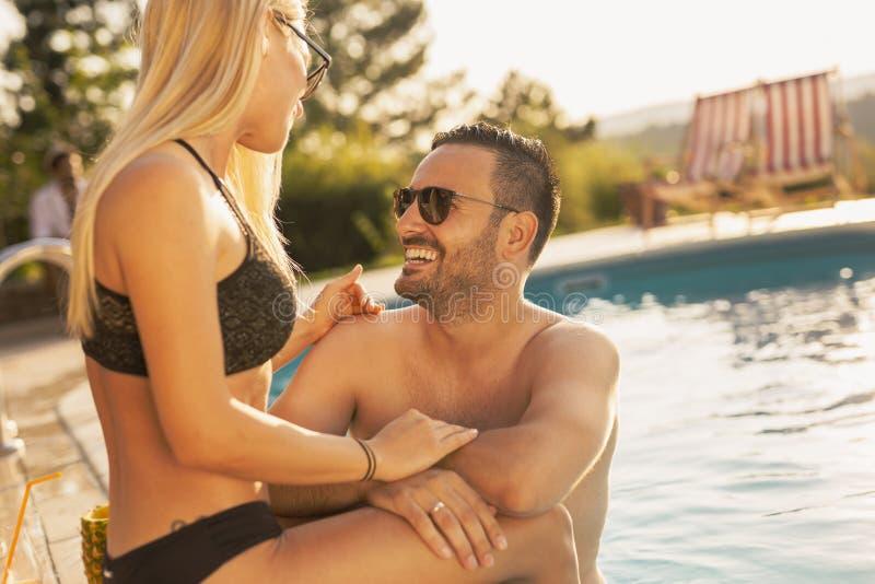 Couple having fun at a swimming pool royalty free stock photos