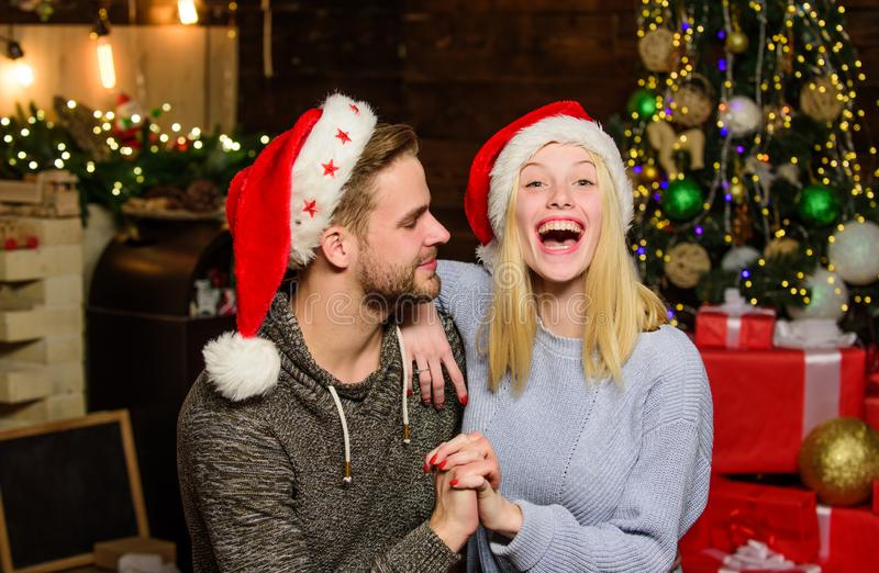 Couple in love red santa hat. Happy family celebrate new year. loving couple portrait. merry christmas. wait for xmas. Gift and present. Winter shopping sales royalty free stock images