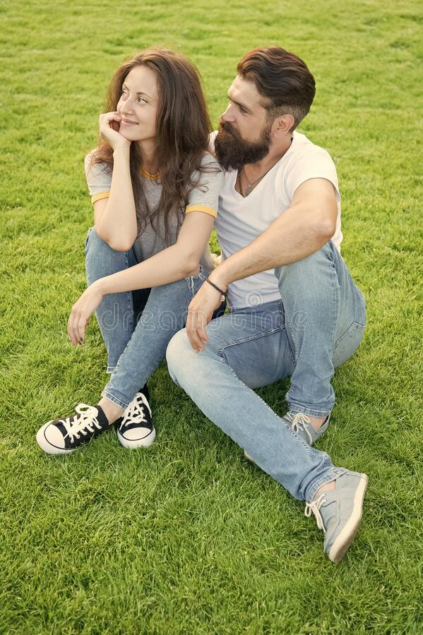 Couple in love relaxing on green lawn. Simple happiness. Couple relations goals. Couple spend time in nature. Playful stock images