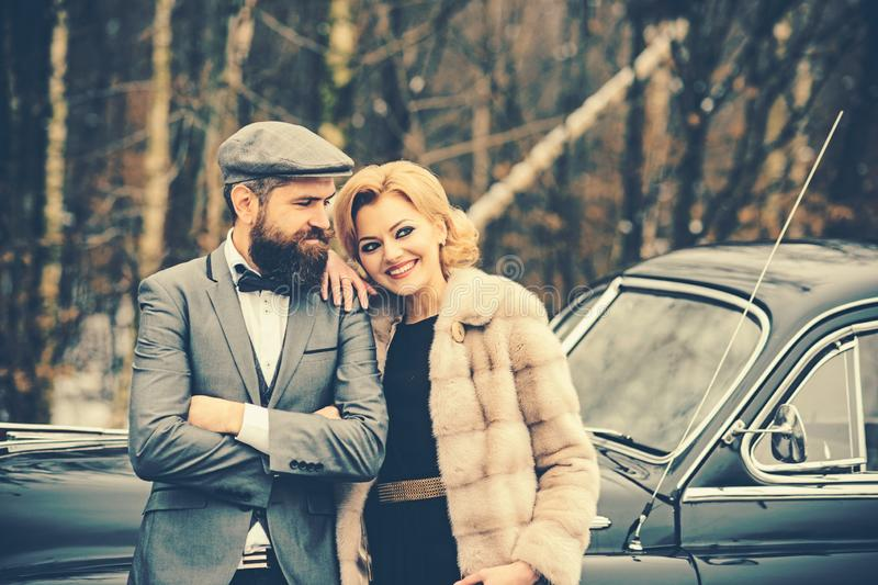Couple in love on romantic date. Escort of girl by security. Retro collection car and auto repair by mechanic driver royalty free stock photo