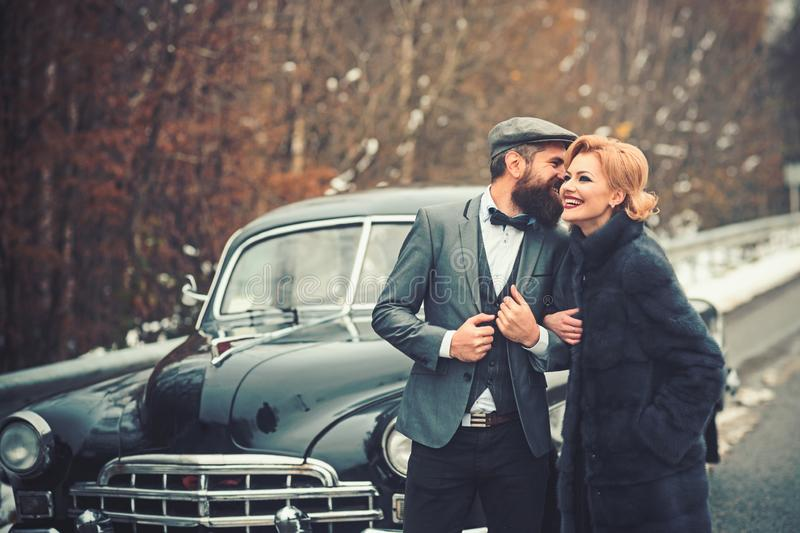 Couple in love on romantic date. Escort of girl by security. Travel and business trip or hitch hiking. Bearded man and royalty free stock photos