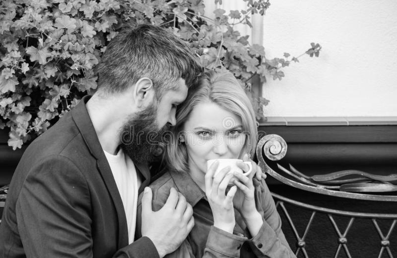Couple in love on romantic date. Morning coffee. First meet of girl and mature man. Brutal bearded hipster and girl stock photography