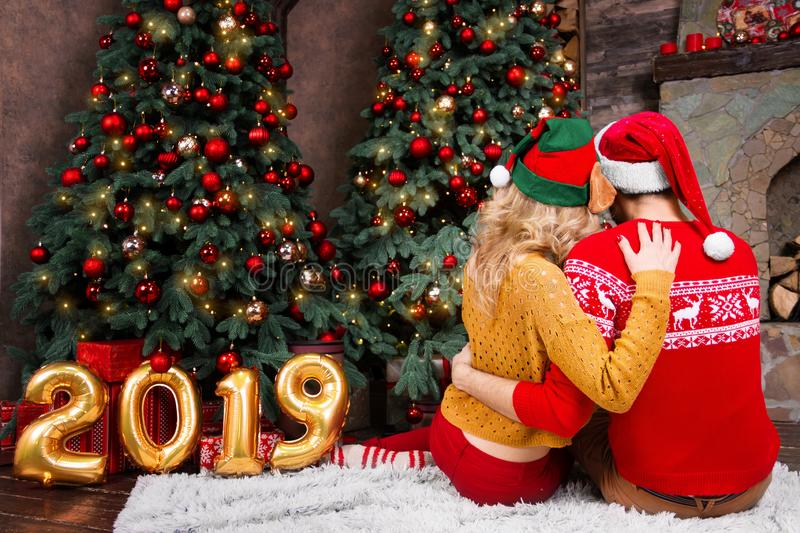 Young happy couple in love during Merry Christmas and Happy New Year holidays royalty free stock images