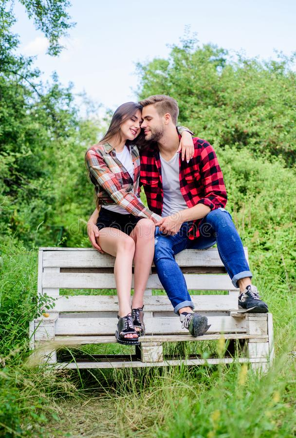 Couple in love sit on bench. Romantic date in park. Summer vacation. Enjoying nice weekend together. Youth hang out stock images