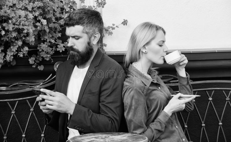 Couple in love sit cafe terrace enjoy coffee. Man secret messaging cheating on wife. Cheat and betrayal. Family weekend royalty free stock photography