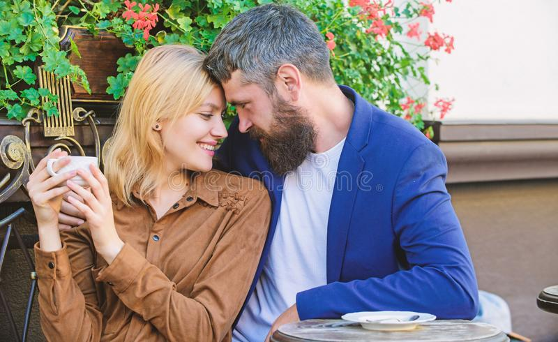 Couple in love sit cafe terrace enjoy coffee. Pleasant family weekend. Explore cafe and public places. Married lovely. Couple relaxing together. Travel and royalty free stock image