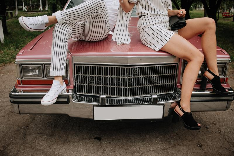 Couple love sit hood retro car hold hands stock image