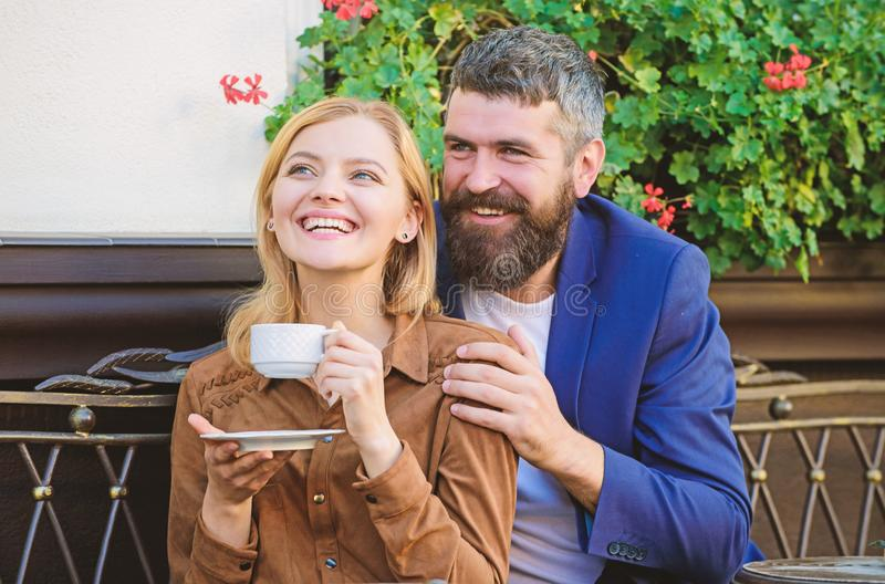 Couple in love sit hug cafe terrace enjoy coffee. Pleasant family weekend. Explore cafe and public places. Married royalty free stock photos