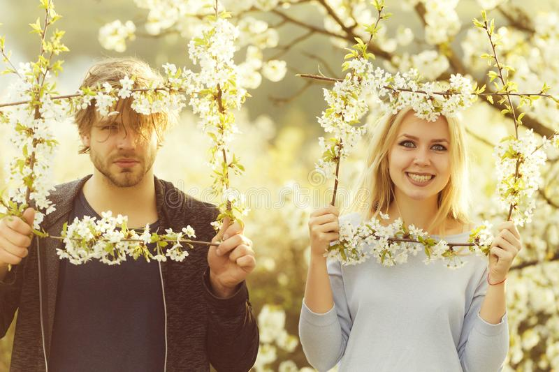 Couple in love, smiling woman and man in flower frame stock photos