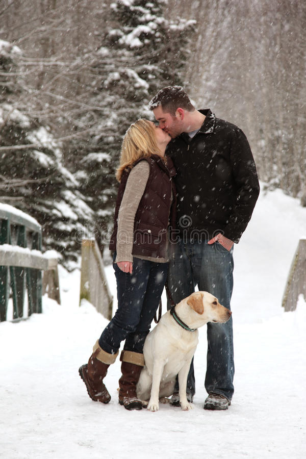 Couple in love in snow royalty free stock photo